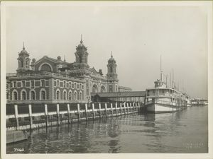 Ellis Island buildings and ferry, early 1900s.