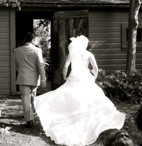 Bride and groom leaving wedding ceremony
