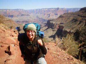 Amy Arden hiking with a backpack in the grand canyon