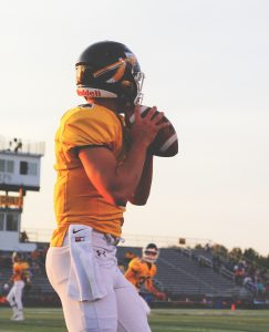 Football quarterback preparing to throw the ball
