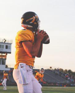 Football quarterback preparing to throw the ball