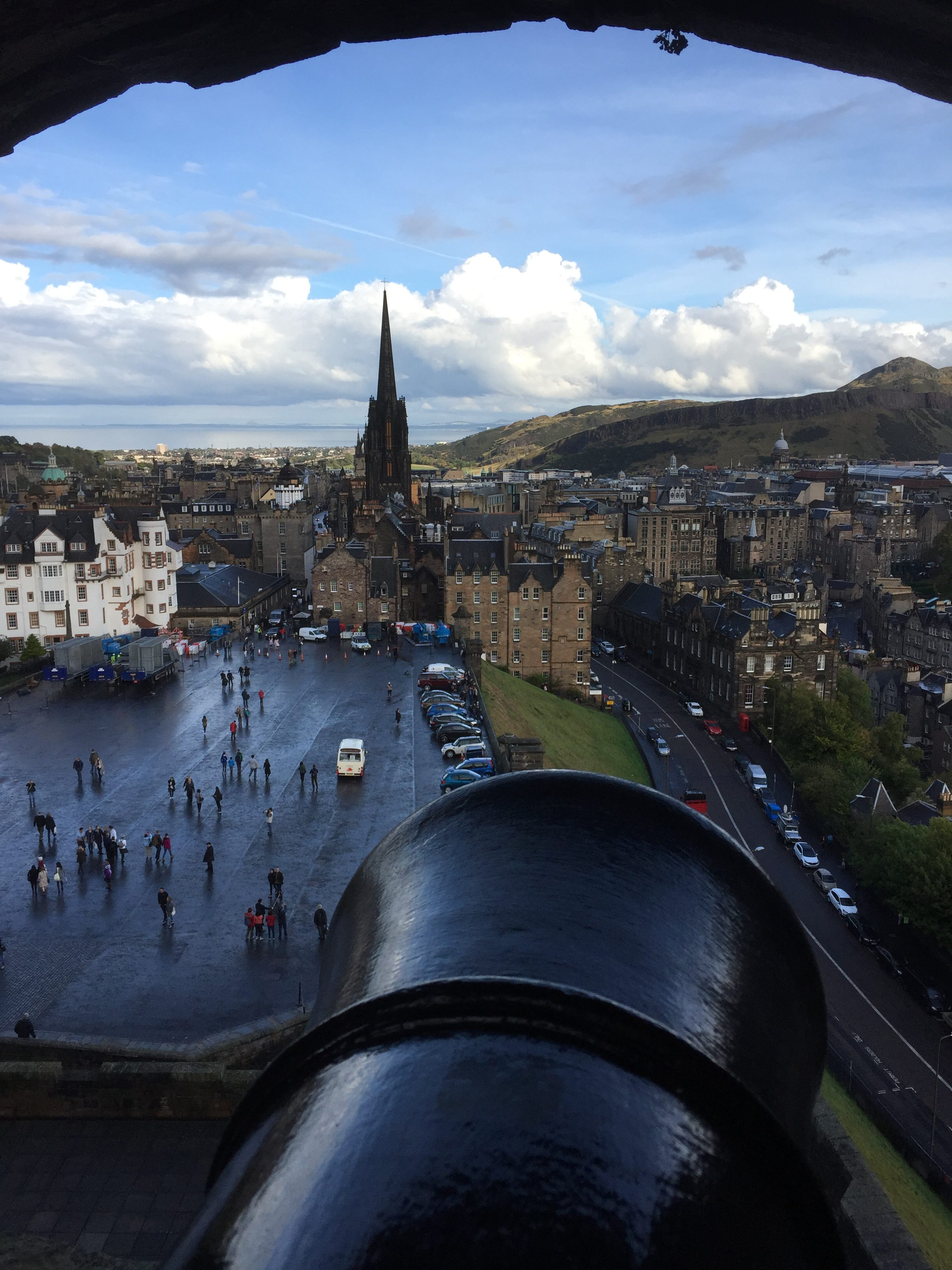 View of the city of Edinburgh while looking over one of the cannons at Edinburgh Castle.